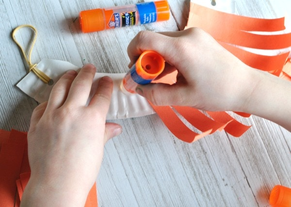 The Re-Stick Glue Stick is great because if kids aren\u0027t happy with where they placed their strips they can easily move them around. & Silly Paper Plate Leprechaun Beard Craft | I Heart Crafty Things