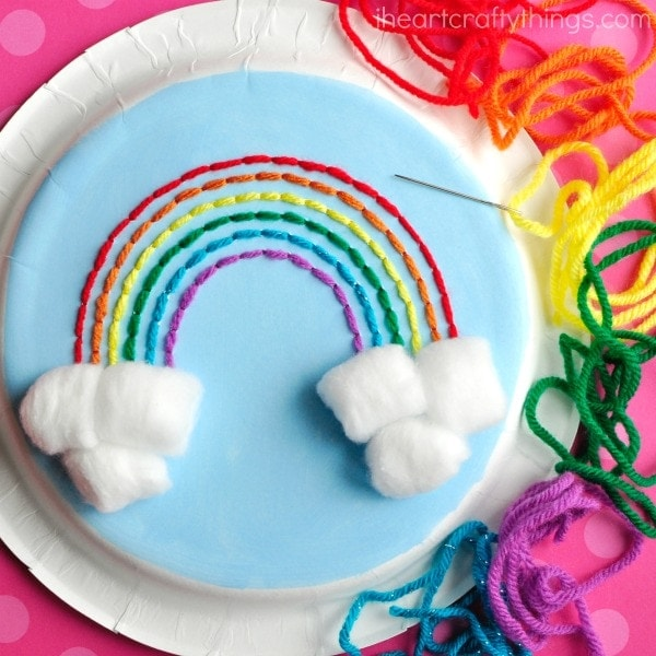 This paper plate rainbow yarn art craft is great for introducing kids to sewing. Great rainbow craft for kids and fun spring kids craft.