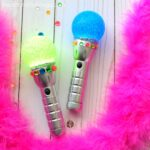 This fun glowing rock star microphone craft is fun for family karaoke night, rock star birthday party activity and SING movie craft for kids.