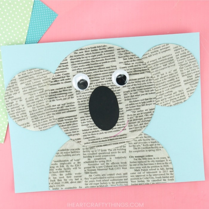 square image of a newspaper koala craft laying flat on a pink background