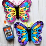 This watercolor and black glue butterfly craft makes a beautiful spring kids craft, art project for kids, butterfly craft for kids and insect craft.