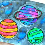 This black glue galaxy craft makes an awesome summer kids craft, solar system crafts, art projects for kids and blue glue art project.