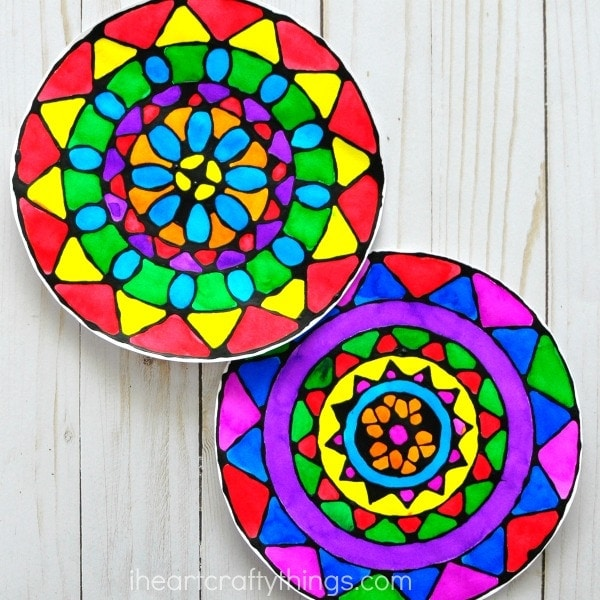 Gorgeous black glue mandala art project for kids with templates. Fun summer kids craft, art projects for kids, black glue art and process art for kids.