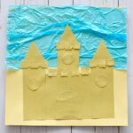 Awesome sand paper sand castle craft for kids. Great beach craft, ocean crafts for kids, sensory craft and preschool shape crafts.