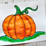 Beautiful black glue pumpkin art project for kids. Great fall kids craft, fall art projects, pumpkin craft and fall crafts for kids.