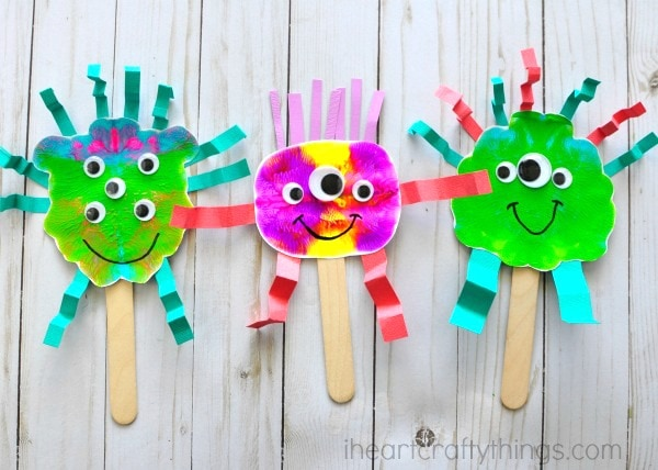 These fun paint smash monster puppets are a great book inspired craft for kids for a monster-themed book. Fun monster craft and kids process art activity.