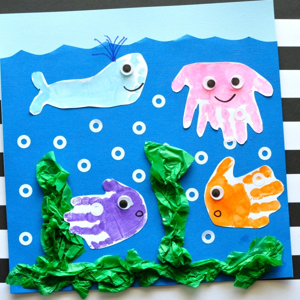 Simple and fun handprint and footprint baby art project. Ocean handprint art for kids, kids handprint crafts, handprint ocean art for kids.