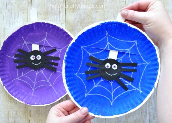 Use a craft knife (adult use only) to cut a slit at the top of your paper plate spider web craft. & Simple and Playful Spider Web Craft | I Heart Crafty Things