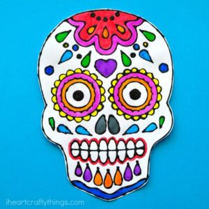 This sugar skull black glue art project is a fun way to celebrate Day of the Dead and Dia de los Muertos. Fun Day of the Dead kids craft.
