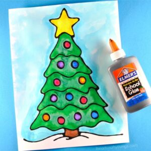 Beautiful black glue Christmas tree art project for kids. Fun Christmas arts and crafts, black glue art for kids and Christmas tree craft.