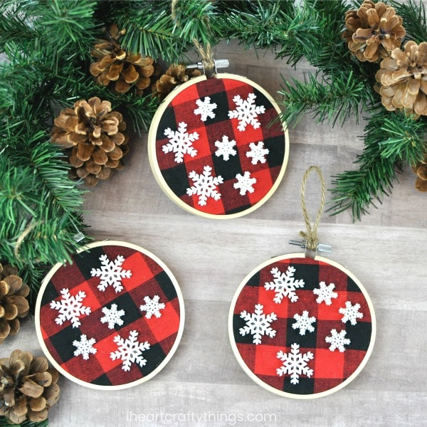 youll create a tightened loop around the top of the buffalo plaid christmas ornament so you can hang it on your christmas tree
