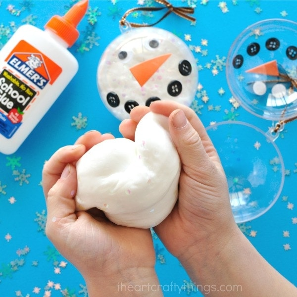 Simple glittery snow slime recipe to make for a fun winter activities for kids. Elmer's glue slime recipes, snowman activities for kids.