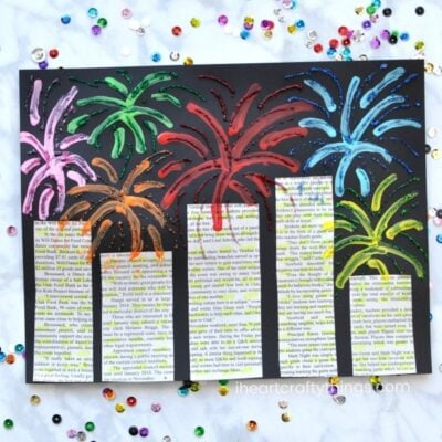 This mixed media New Year's Eve Fireworks Craft is a great art project for kids of all ages to make for your New Year's Eve celebration. The use of newspaper gives this beautiful fireworks craft a fun recycled element and the bright colors and sparkly glitter glue make the fireworks pop off the paper.
