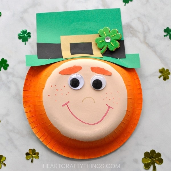 I'm a redhead so naturally I get uberexcited when St. Patrick's Day rolls around every year and I have an excuse to make cute little orange-haired leprechaun crafts. This paper bowl leprechaun craft is super easy to make for a fun St. Patrick's Day arts and crafts activity.
