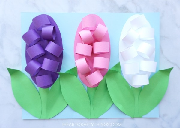 How to make paper hyacinth flowers i heart crafty things we added three paper hyacinth flowers onto our paper but you can choose to add however many youd like mightylinksfo