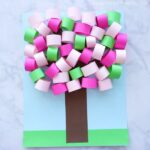 This 3D Spring paper tree craft is a fun paper craft for kids to help celebrate the beginning of the spring season.The beautiful light and dark pink colors mixed with the green is reminiscent of pretty cherry blossom trees that come to life every spring.