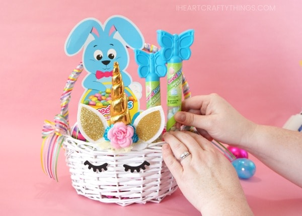 How to make a diy unicorn easter basket i heart crafty things surround the sweetarts candy with some colorful plastic easter eggs filled with other surprises inside the basket you now have a beautiful easter basket negle Images