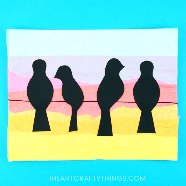 Learn how simple it is to create this birds on a wire art project. Yellow, orange, pink and blue tissue paper is layered to achieve a sunset background and the addition of the black bird silhouette's help the sunset colors pop off the page.Gorgeous bird art project for kids and silhouette art project for kids.