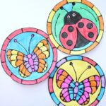 Celebrate the spring season by creating this colorful black glue spring art project. The round, stained glass templates have a fluttering butterfly or a cute ladybug in the center. See how easy it is to create this faux stained glass look with black glue and watercolors.
