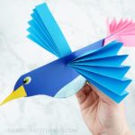 Learn how to make this colorful, easy paper bird craft. -Fun paper craft for kids of all ages! More simple bird crafts and spring crafts for kids here too.
