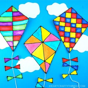 This gorgeous black glue kite art project is a perfect compliment to a family afternoon of flying kites at the park on a windy day. It is also a fun art project to make this summer when you are indoors and want to avoid the afternoon heat. Pretty kite craft and summer art project.