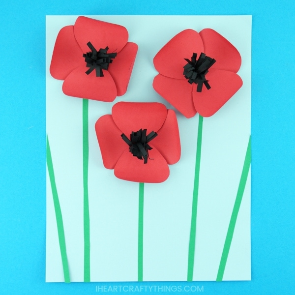 Learn how easy it is to make this simple paper poppies craft. The combination of the red flower petals popping of the page along with black strips coming out from the middle of the flowers gives this pretty paper poppies craft an awesome 3-dimensional effect. Great Remembrance Day Craft and Poppy Craft for kids.
