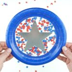 This paper plate patriotic suncatcher craft is perfectly festive for Independence Day and kids will have a blast making it. Great Fourth of July kids craft.