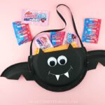 This paper plate Halloween candy holder is a great Halloween craft for kids to make at a Halloween party. Fun bat craft and Halloween paper plate crafts.