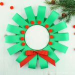 This paper plate Christmas wreath craft is super easy to make and is perfect for kids of all ages. Fun paper plate Christmas craft for kids.