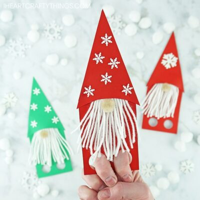 Use our free template to make these adorable gnome craft finger puppets. Fun Christmas gnome craft, garden gnome craft and winter kids craft.