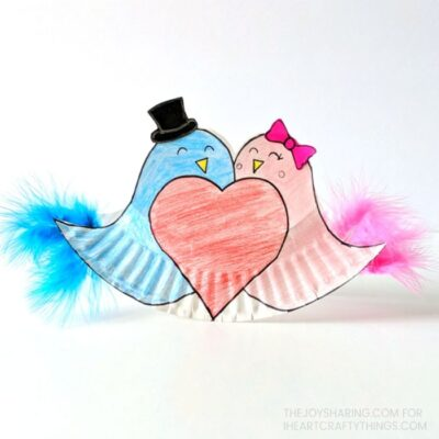 Kids will love making and playing with this adorable rocking paper plate love birds craft. Fun Valentine's Day craft for kids of all ages.