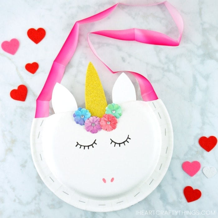 Learn how easy it is to make this paper plate unicorn Valentine holder. Fun alternative to a unicorn Valentine box for toddlers and preschoolers.
