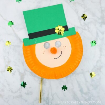 Here's a fun and easy way to create a leprechaun mask out of a paper plate. Simple St. Patrick's Day craft for preschoolers and kids.