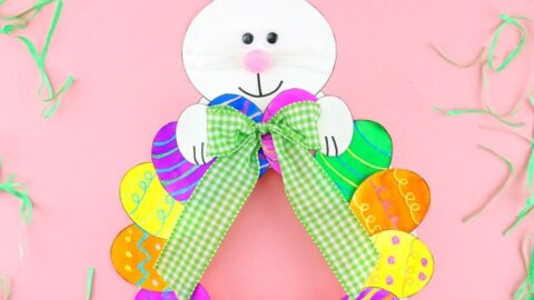 This colorful paper plate Easter Egg Wreath is a simple and easy Easter Craft idea for kids of all ages to make. Cute Easter decoration for home.