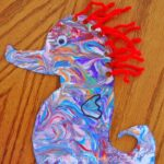 Create your own Mister Seahorse Craft using this creative shaving cream marbled painting technique. This ocean themed art project is the perfect companion to Eric Carle's book!