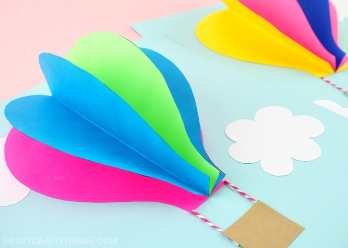 Use our free template to create this gorgeous paper hot air balloon craft. Fun 3D paper craft and summer craft for preschoolers and kids of all ages.