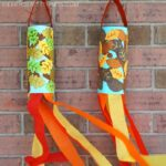 Easy fall windsock craft for preschoolers and toddlers. Fun fall craft for kids to explore the colors of the fall season.