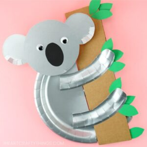 silver paper plate koala craft holding cardboard tree branch with green leaves