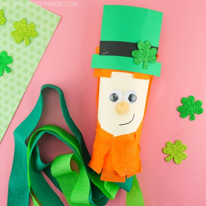 leprechaun windsock craft laying down on pink background