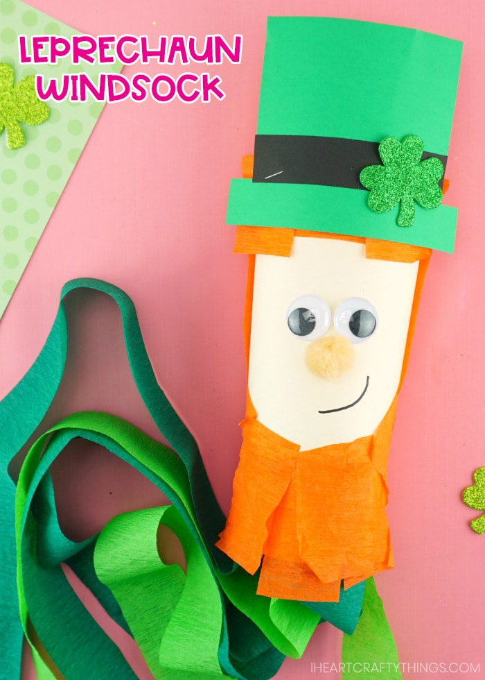 close up of leprechaun windsock laying on pink background