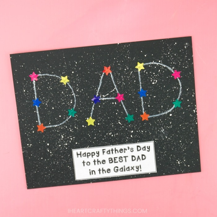 Finished DAD constellation craft laying flat at an angle on a pink background