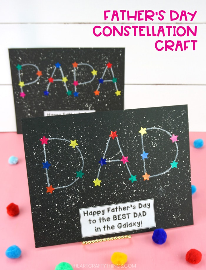 vertical image of Father's Day constellation craft on pink table with white shiplap background. DAD constellation is front and in focus and PAPA constellation is blurry in background.