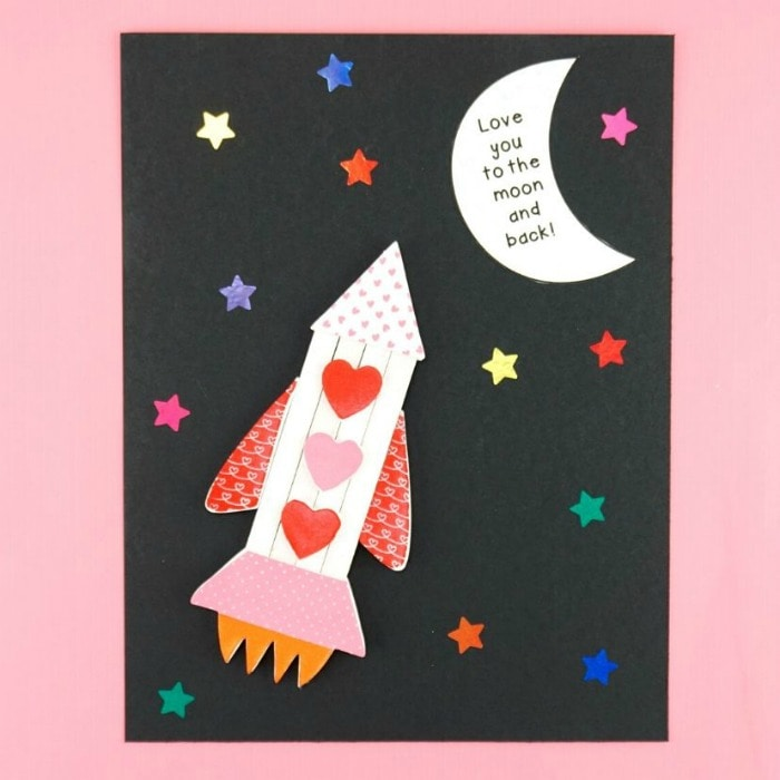 rocket ship Valentine's Day craft laying flat on a pink background