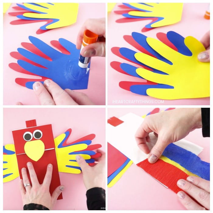 Four image collage showing adult gluing the handprints together to make parrot wings and then gluing them on the inside of the parrot puppet, then gluing crepe paper on the back of the puppet for tail feathers.