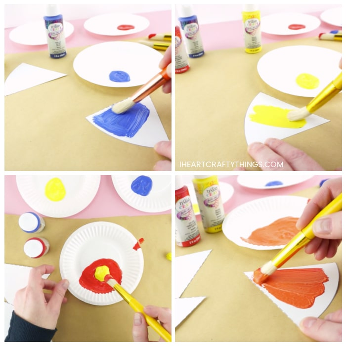 Four image color showing someone painting one of the color wheel triangles with blue paint and yellow paint. Then mixing the red and orange paint together to make orange and painting a section of the color wheel with the orange paint.