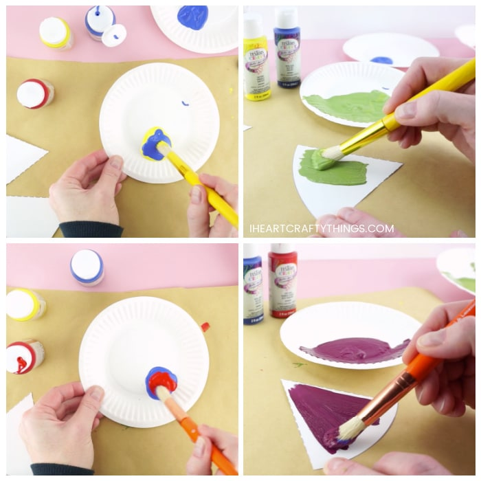 Four image collage with top two photos showing someone mixing together blue and yellow paint to make green and painting a color wheel section with it. Then the bottom two photos showing someone mixing red and blue paint to make purple and painting a color wheel piece with it.