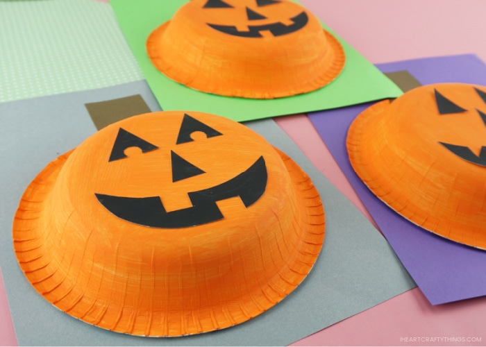Close up image of paper bowl pumpkin craft taken from an angle that shows the bowl popping off the cardstock paper.