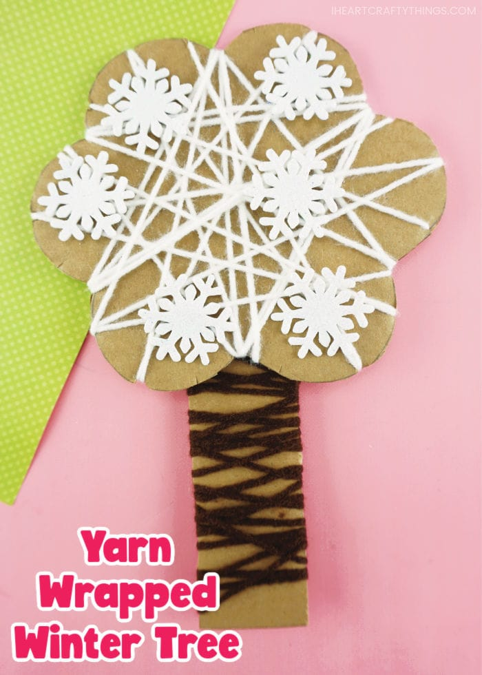 """Vertical close up image of yarn wrapped winter craft with the words """"Yarn wrapped winter tree"""" in the bottom left corner."""