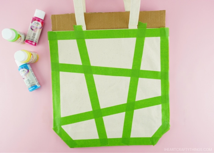 Example of how to place the painters tape on the front of the canvas bag to make geometric painted shapes.