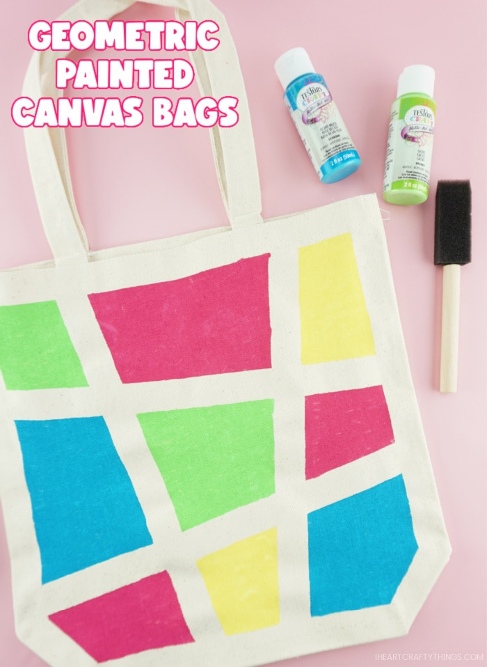 """Close up vertical image of finished canvas bag project with the words """"Geometric Painted Canvas Bags"""" in the top left corner."""